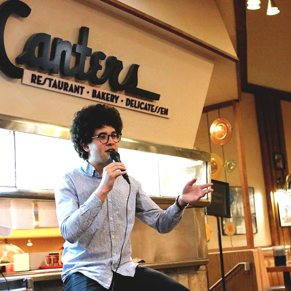 Alex Canter speaking in Canters Deli.